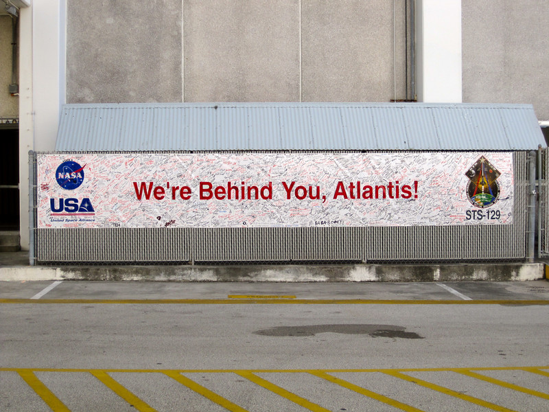 Hundreds (thousands?) of signatures fill this banner in support of the Atlantis mission. Photo by Jim Lovett