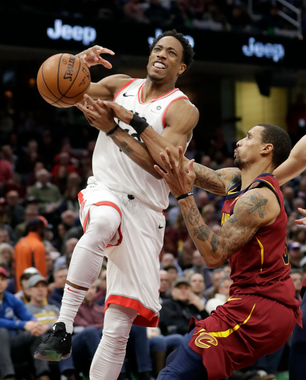 . Toronto Raptors\' DeMar DeRozan, left, loses control of the ball against Cleveland Cavaliers\' George Hill in the first half of an NBA basketball game, Wednesday, March 21, 2018, in Cleveland. (AP Photo/Tony Dejak)