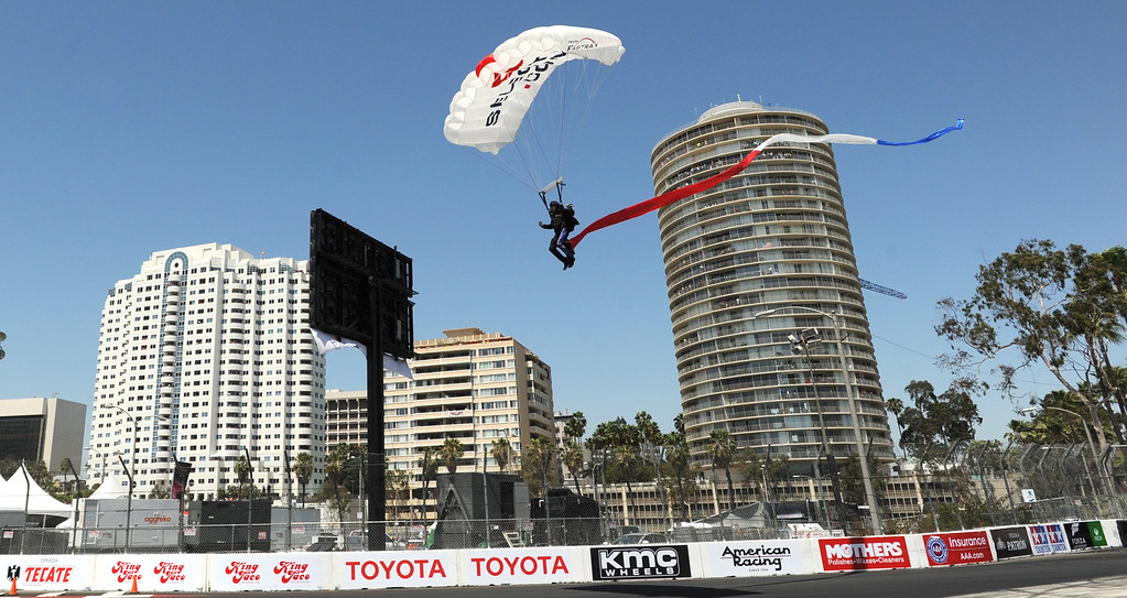 . A skydiver lands on the track before the start of the 41st Annual Toyota Grand Prix of Long Beach.  Long Beach  Calif., Sunday,  April,19, 2015.     (Photo by Stephen Carr / Daily Breeze)