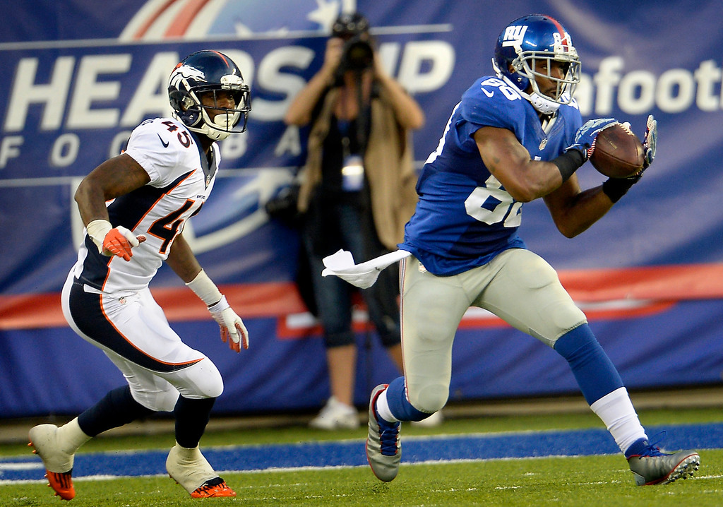 . Wide receiver Hakeem Nicks (88) of the New York Giants makes a catch in frnt of cornerback Dominique Rodgers-Cromartie (45) of the Denver Broncos to make it first and 9 on the 9 yard line  at METLIFE Stadium. September 15, 2013 East Rutherford, NJ. (Photo By Joe Amon/The Denver Post)