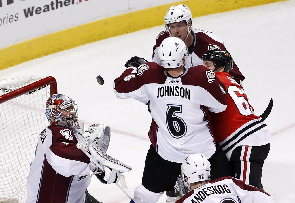 . Colorado Avalanche goalie Semyon Varlamov (1) keeps an eye on the puck as defenseman Erik Johnson (6) and Jan Hejda (8) defend against Chicago Blackhawks center Andrew Shaw, during the third period of an NHL hockey game Tuesday, Jan. 6, 2015, in Chicago. The Avalanche won 2-0. (AP Photo/Charles Rex Arbogast)