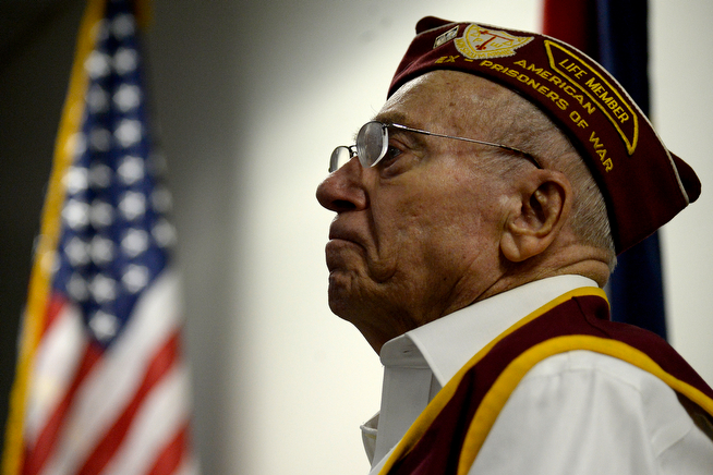 . Recipient Frank Dechant listens to remarks during his POW Medal presentation at the office of U.S. Rep. Ed Perlmutter. Lakewood POW medal ceremony on Monday, April 14, 2014. (Photo by AAron Ontiveroz/The Denver Post)