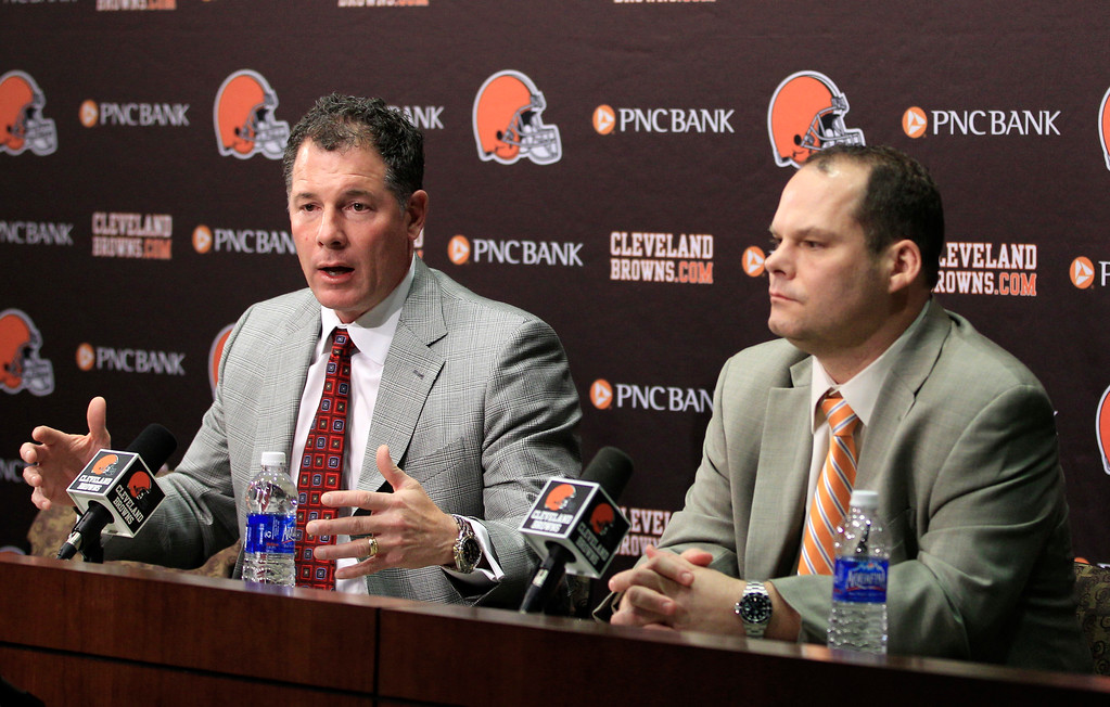 . Cleveland Browns coach Pat Shurmur, left, answers questions as general manager Tom Heckert listens at the Browns\' training facility Thursday, April 26, 2012, in Berea, Ohio. The Browns picked running back Trent Richardson and quarterback Brandon Weeden in the first round of the NFL football draft. (AP Photo/Tony Dejak)