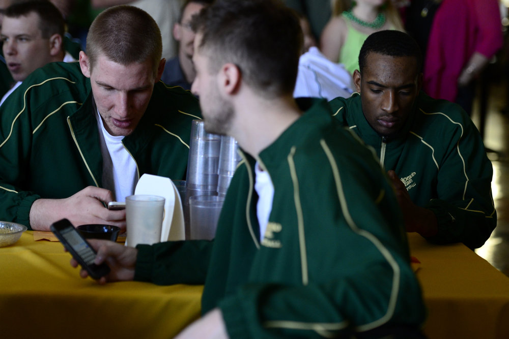 . CSU players Colton Iverson (left) and Greg Smith await their seeding during the NCAA tournament selection show. The Rams earned an eight seed and will play ninth-seeded Missouri in the second round. (Photo by AAron Ontiveroz/The Denver Post)