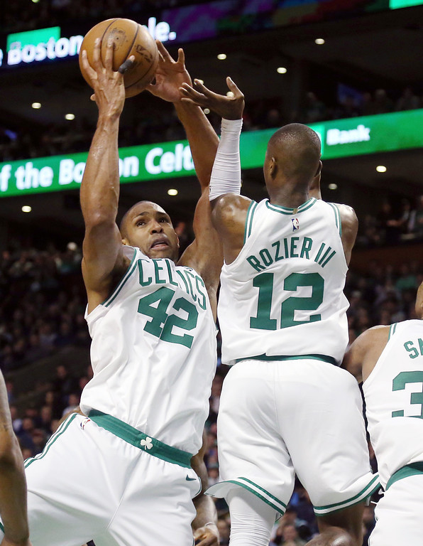 . Boston Celtics forward Al Horford (42) grabs a rebound in front of guard Terry Rozier during the first half in Game 7 of the NBA basketball Eastern Conference finals against the Cleveland Cavaliers, Sunday, May 27, 2018, in Boston. (AP Photo/Elise Amendola)