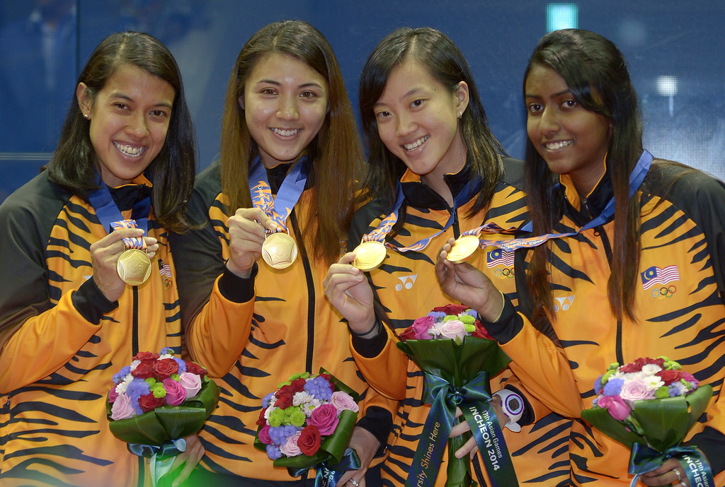 . Gold medalist Malaysia\'s (L to R): David Nicol Ann, Arnold Delia Odette, Low Wee Wern and Vanessa Raj Gnanasigamani pose during the medal ceremony for the women\'s squash team final round at the 2014 Asian Games in Incheon on September 27, 2014. PORNCHAI KITTIWONGSAKUL/AFP/Getty Images