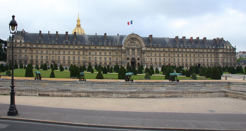 This is the front side of the Hotel les Invalides complex that faces the Seine River which is still some distance away beyond a long plaza and past the Eiffel Tower.