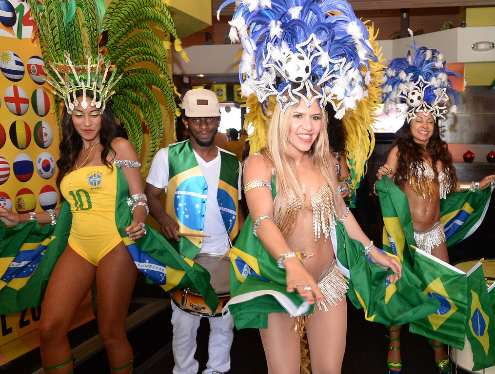 . Patricia Rocha dances with the LA Samba Dancers as Brazil soccer fans crowded into Samba restaurant to watch the FIFA World Cup game against Croatia Thursday, June 12, 2014, Redondo Beach, CA.  The South Bay is home to a large Brazilian community. Photo by Steve McCrank/Daily Breeze