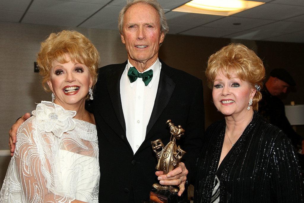 . Actress Ruta Lee, director Clint Eastwood and actress Debbie Reynolds attend the Thalians\' 53rd Annual Ball held at the Beverly Hilton Hotel on November 5, 2008 in Beverly Hills, California.  (Photo by Alberto E. Rodriguez/Getty Images)