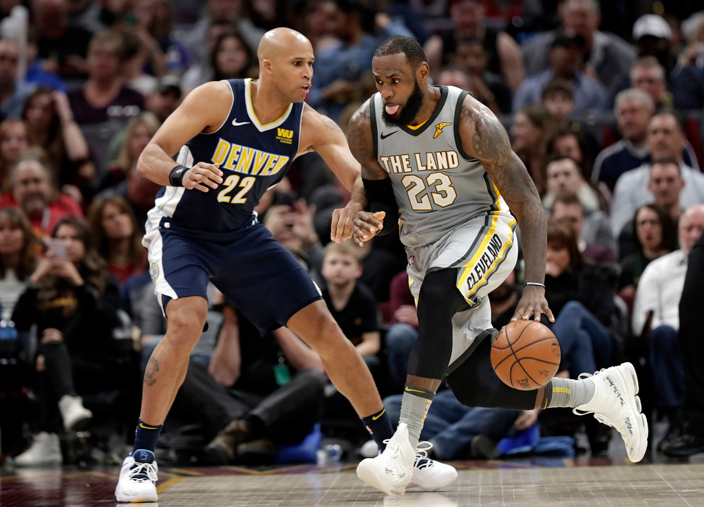 . Cleveland Cavaliers\' LeBron James (23) drives against Denver Nuggets\' Richard Jefferson (22) in the second half of an NBA basketball game, Saturday, March 3, 2018, in Cleveland. The Nuggets won 126-117. (AP Photo/Tony Dejak)