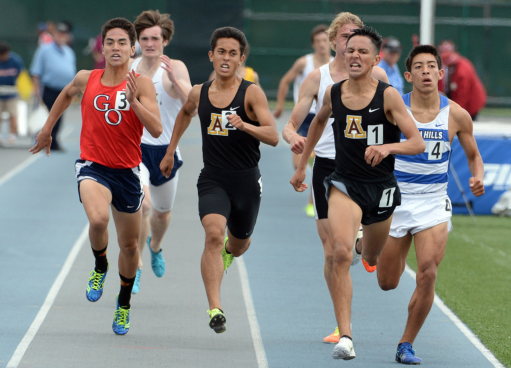 . Arcadia\'s Estevan De La Rosa, right, wins the division 2 1600 meter run past teammate Phillip Rocha during the CIF Southern Section track and final Championships at Cerritos College in Norwalk, Calif., Saturday, May 24, 2014.   (Keith Birmingham/Pasadena Star-News)