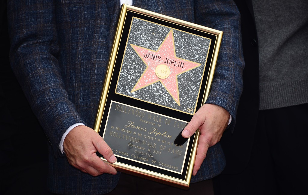 . A plaque honoring the late Janis Joplin with her Hollywood \'Star\' is held by her brother Michael during a posthumous Hollywood Star ceremony on November 4, 2013 in Hollywood, California. Joplin, who had her siblings Michael and Laura at the ceremony, would have turned 70 years old this year and is the recipient of the 2,510th Star on the Hollywood Walk of Fame in the Category of Recording.         (FREDERIC J. BROWN/AFP/Getty Images)