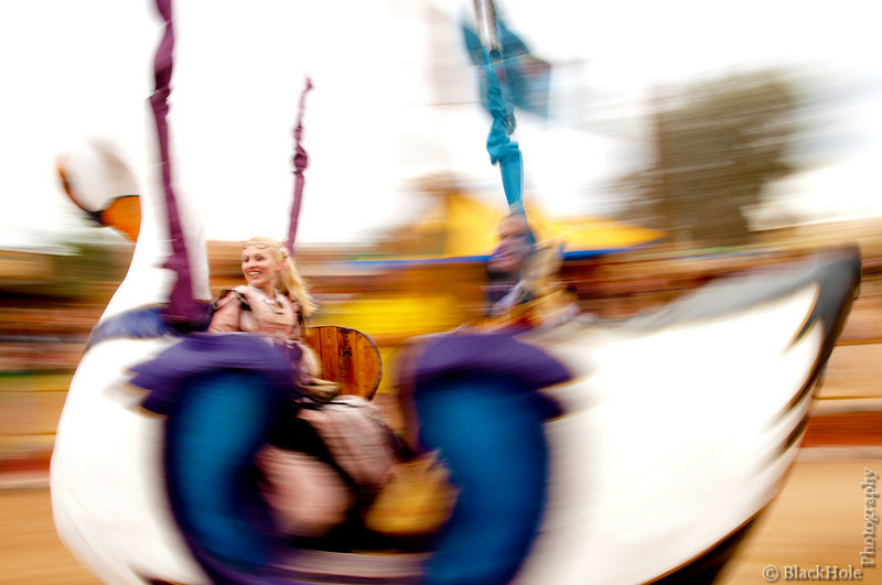 """Motion - """"Dreams of Swans in Flight"""" - Alanta and Kylie enjoying a ride on the Swan Swing through a Dream World blurred by motion."""