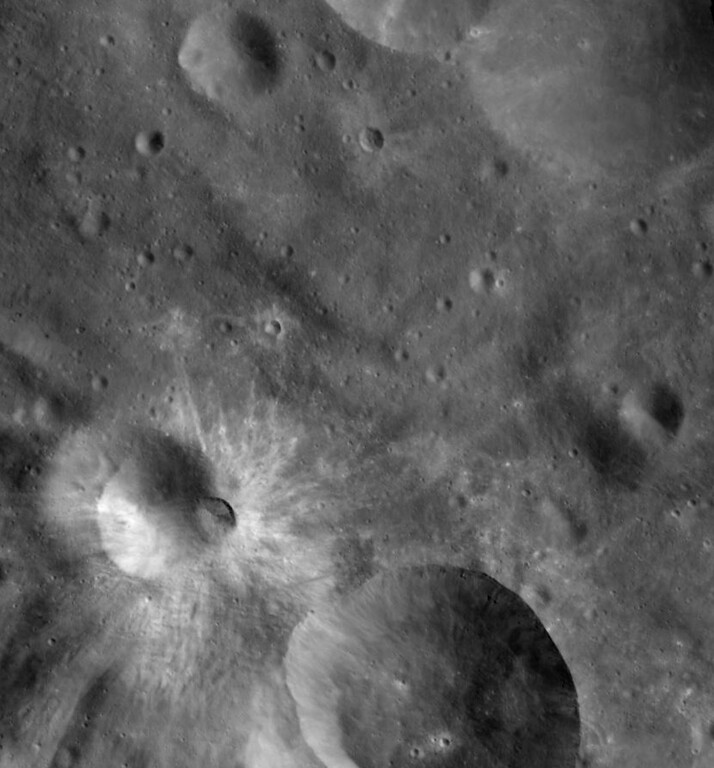 . This image released Monday, Dec. 5, 2011, by NASA is a mosaic of three images taken by the Dawn spacecraft\'s camera showing an impact crater on the surface of the massive asteroid Vesta. Since entering orbit around Vesta in July, Dawn has been beaming back images of the asteroid surface. (AP Photo/NASA)