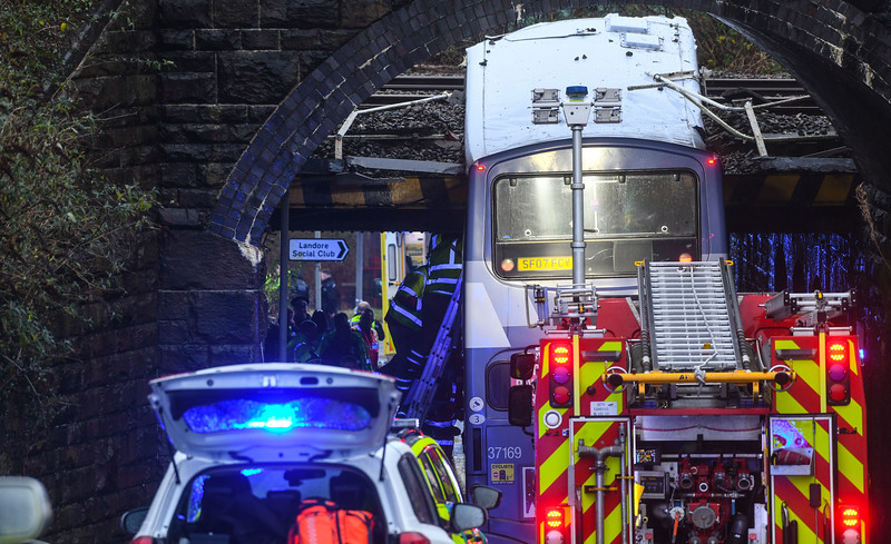 Swansea, 12th December 2019 Emergency services attend to a serious incident in Swansea, South Wales after a double decker bus collided with a railway bridge causing the roof to be torn off.