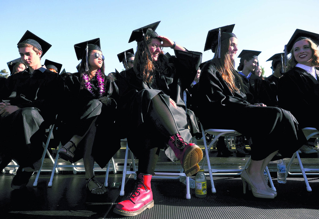 . Pacific Collegiate School students donned cap, gown, and the occasional pair of flashy shoes Friday evening for the class of 2013 commencement ceremony. The ceremony featured student and faculty speakers and several musical performances. (Matthew Hintz/Sentinel)