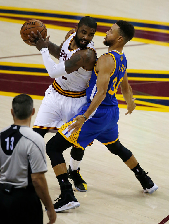 . Cleveland Cavaliers guard Kyrie Irving (2) is guarded by Golden State Warriors guard Stephen Curry (30) during the first half of Game 3 of basketball\'s NBA Finals in Cleveland, Wednesday, June 7, 2017. (AP Photo/Ron Schwane)
