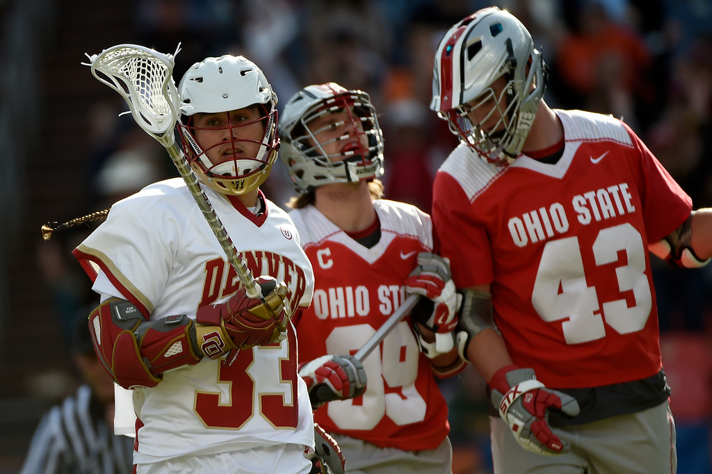 . Zach Miller (33) of the Denver Pioneers scores as  Evan Mulchrone (39) of the Ohio State Buckeyes and  Erik Evans (43) react during the first half of their NCAA tournament quarterfinal match. The Denver Pioneers played the Ohio State Buckeyes at Sports Authority field at Mile High on Saturday, May 16, 2015. (Photo by AAron Ontiveroz/The Denver Post)