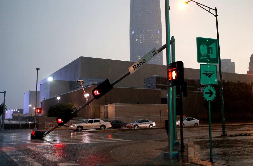 . A traffic light rests on the street on E K Gaylord and Reno in Oklahoma City after a storm moves through the area in Oklahoma City, Friday, May 31, 2013. (AP Photo/The Oklahoman, Bryan Terry)