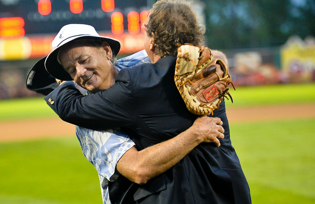 . Team owners and friends Bill Murray, left, and Mike Veeck hug after being introduced before the game. (Pioneer Press: Ben Garvin)