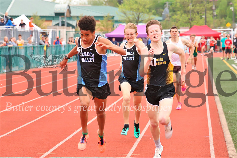 Seneca's Sam Owori (left), Connor Volk-Klos (center) and Zach Kinne of North Allegheny push down the final stretch of the boys 1,600 meter. Kinne took first Owori second Volk-Klos third. All three broke the meet record. Seb Foltz/Butler Eagle