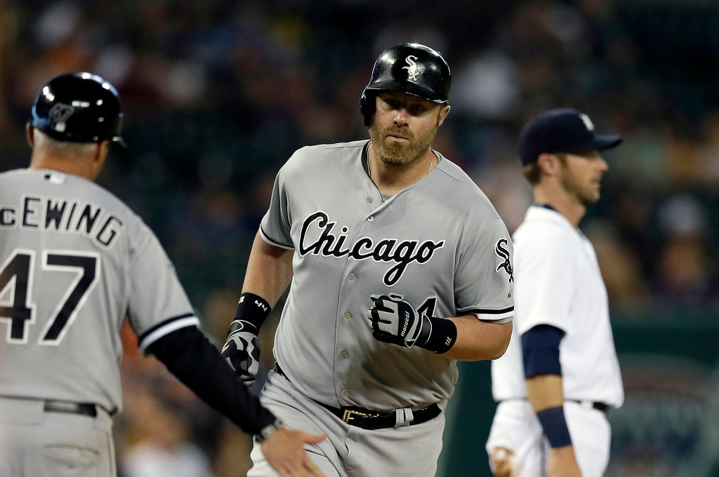 . Chicago White Sox designated hitter Adam Dunn rounds the bases after his solo home run during the ninth inning of a baseball game against the Detroit Tigers, Wednesday, July 30, 2014 in Detroit. (AP Photo/Carlos Osorio)