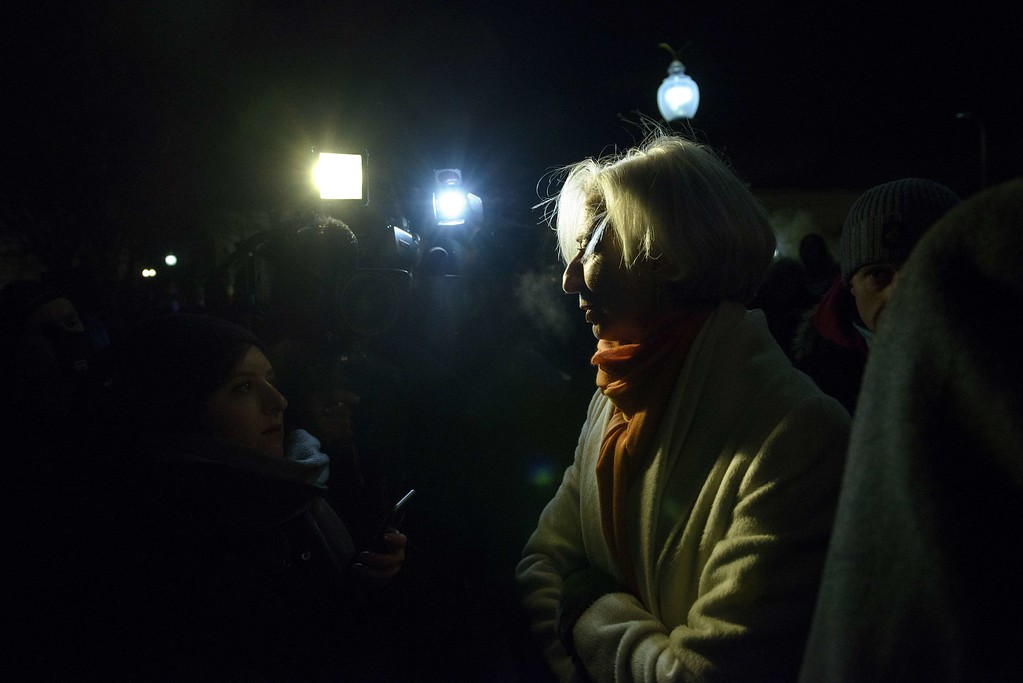 . Christine Lagarde, Managing Director of the International Monetary Fund (IMF), talks with reporter while visiting people outside the Newseum January 7, 2015 in Washington, DC during a vigil in solidarity with the victims of the shooting at the Paris office of the satirical newspaper Charlie Hebdo by three gunman that took the lives of 12 people. AFP PHOTO / BRENDAN SMIALOWSKIBRENDAN SMIALOWSKI/AFP/Getty Images