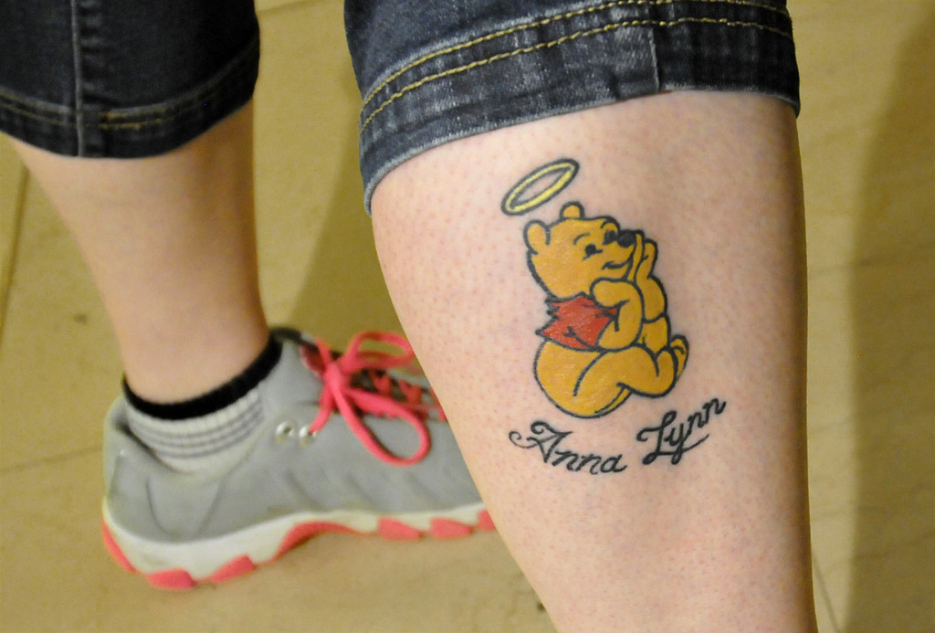 . Penny Griffin shows a tattoo dedicated to her slain 16-year-old niece. (Pioneer Press: John Doman)