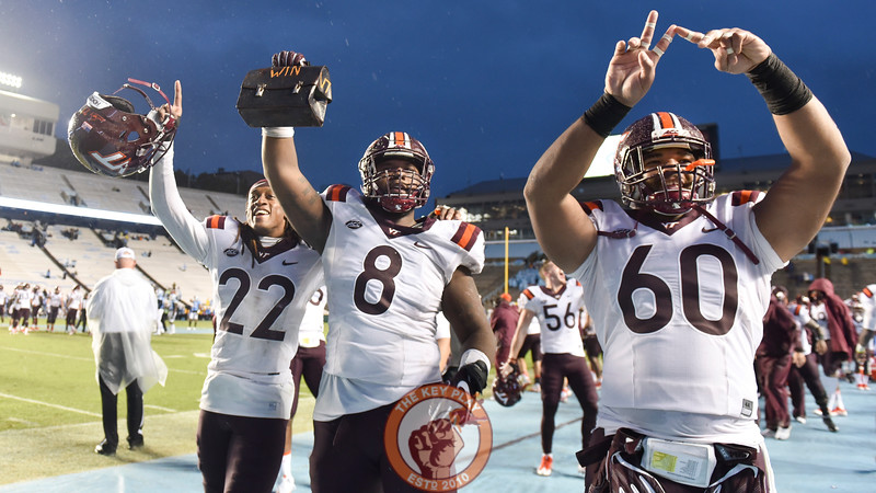 Virginia Tech defensive tackle Nigel Williams (8) carries the lunch pail and celebrates with teammates defensive tackle Woody Baron (60) and rover Terrell Edmunds (22) late in the fourth quarter. (Michael Shroyer/ TheKeyPlay.com)