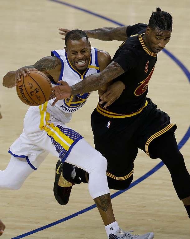 . Golden State Warriors forward Andre Iguodala, left, dribbles against Cleveland Cavaliers guard Iman Shumpert during the second half of Game 2 of basketball\'s NBA Finals in Oakland, Calif., Sunday, June 4, 2017. (AP Photo/Ben Margot)