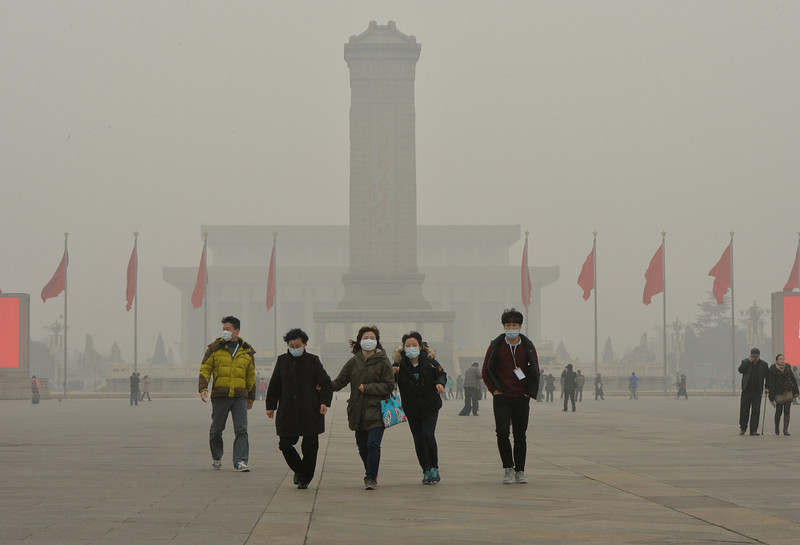 . Chinese tourists wearing face masks visit Tiananmen Square as heavy air pollution continues to shroud Beijing on February 26, 2014. Beijing\'s official reading for PM 2.5, small airborne particles which easily penetrate the lungs and have been linked to hundreds of thousands of premature deaths, stood at 501 micrograms per cubic metre.  (MARK RALSTON/AFP/Getty Images)