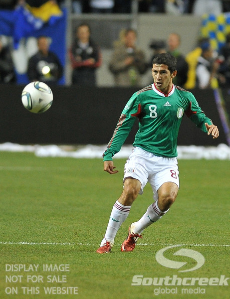 Mexico's Midfielder Israel Castro (#8) watches his pass during Soccer action between Bosnia-Herzegovina and Mexico.  Mexico defeated Bosnia-Herzegovina 2-0 in the game at the Georgia Dome in Atlanta, GA.