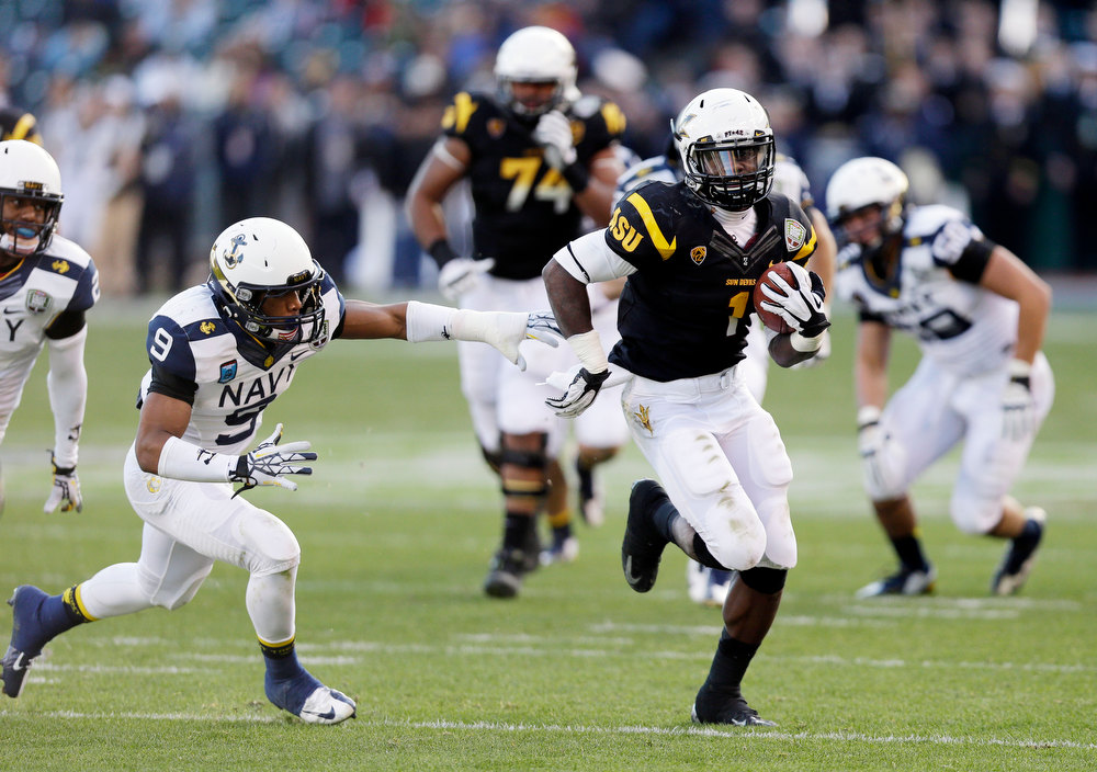 Description of . Arizona State running back Marion Grice (1) runs past Navy safety Tra'ves Bush (9) on a 39-yard touchdown run during the second half of the Fight Hunger Bowl NCAA college football game in San Francisco, Saturday, Dec. 29, 2012. (AP Photo/Marcio Jose Sanchez)