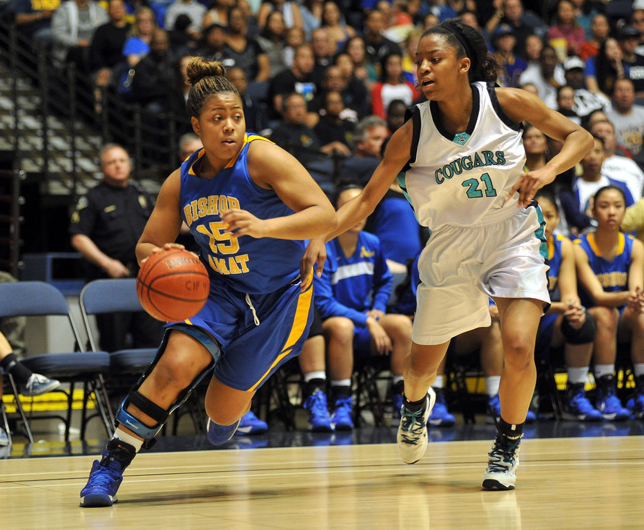 . Bishop Amat\'s Leeah Powell (#15) tries to fend off Canyon Springs\' Chariaha Scott (#21) in the CIF-SS Division 1A girls basketball finals at the Anaheim Arena on Friday March1, 2013. Canyon Springs beat Bishop Amat 48-46. (SGVN/Staff Photo by Keith Durflinger)