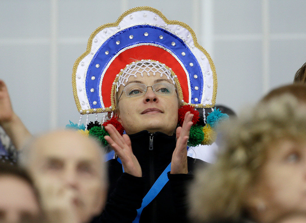 . A fan watches the women\'s 3000-meter speedskating competition at the 2014 Winter Olympics, Sunday, Feb. 9, 2014, in Sochi, Russia. (AP Photo/Morry Gash)