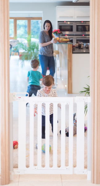 Fred_Stairgates_Screw_Fit_Wooden_Gate_Lifestyle_white_family_through_playing.jpg