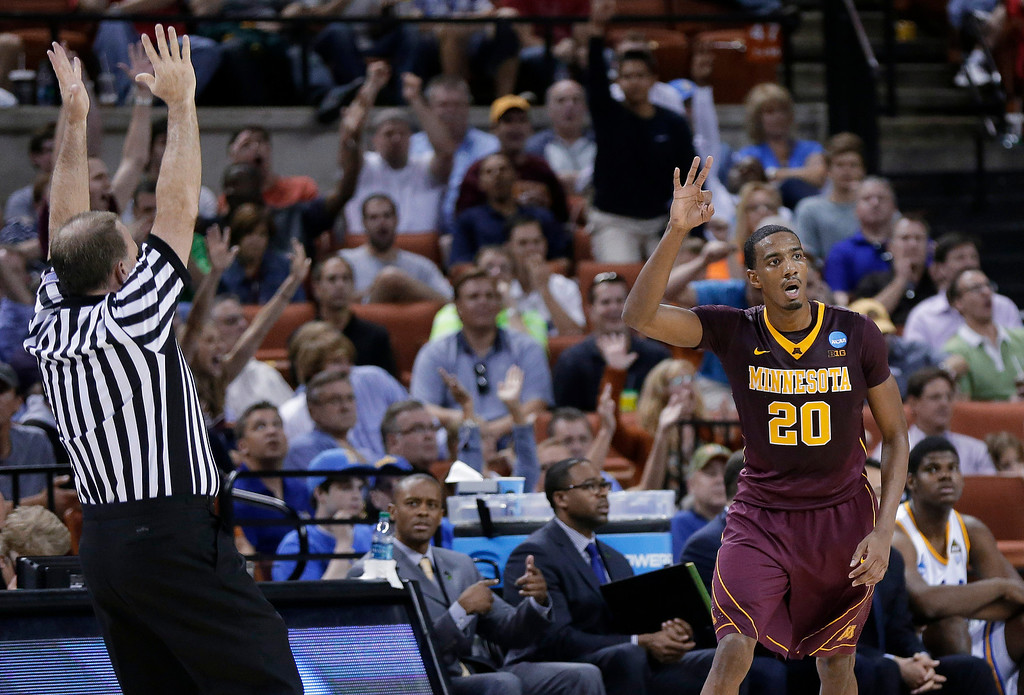 . Minnesota\'s Austin Hollins (20) gestures after a 3-point shot against UCLA during the first half of a second-round game of the NCAA men\'s college basketball tournament Friday, March 22, 2013, in Austin, Texas.  (AP Photo/Eric Gay)