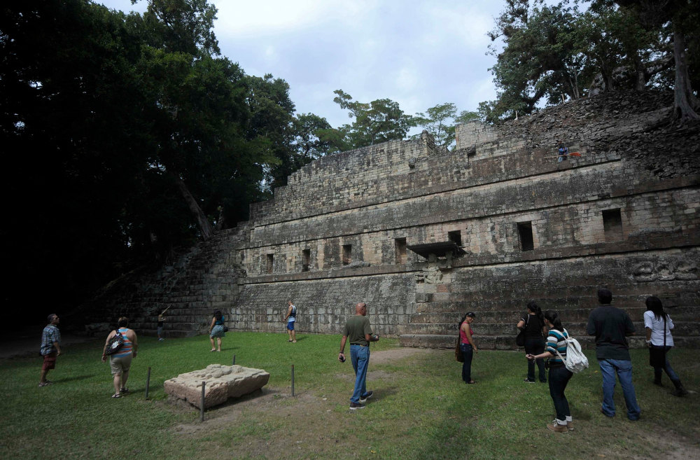 . Visitors tour the archaeological site of the Maya civilization of Copan, Honduras, December 19, 2012. This week, at sunrise on Friday, December 21, an era closes in the Maya Long Count calendar, an event that has been likened by different groups to the end of days, the start of a new, more spiritual age or a good reason to hang out at old Maya temples across Mexico and Central America. REUTERS/Jorge Cabrera