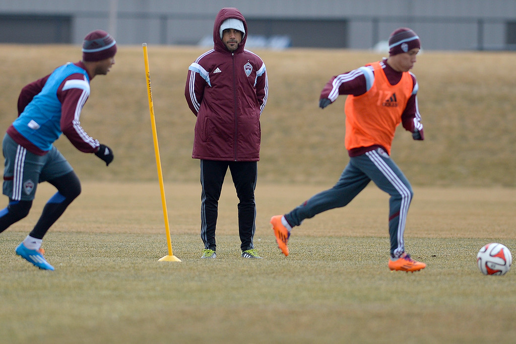 . Colorado Rapids head coach Pablo Mastroeni watches as his club runs through drills during practice. Colorado Rapids practice before their season opener at Dick\'s Sporting Goods Park on Tuesday, March 11, 2014.(Photo by AAron Ontiveroz/The Denver Post)