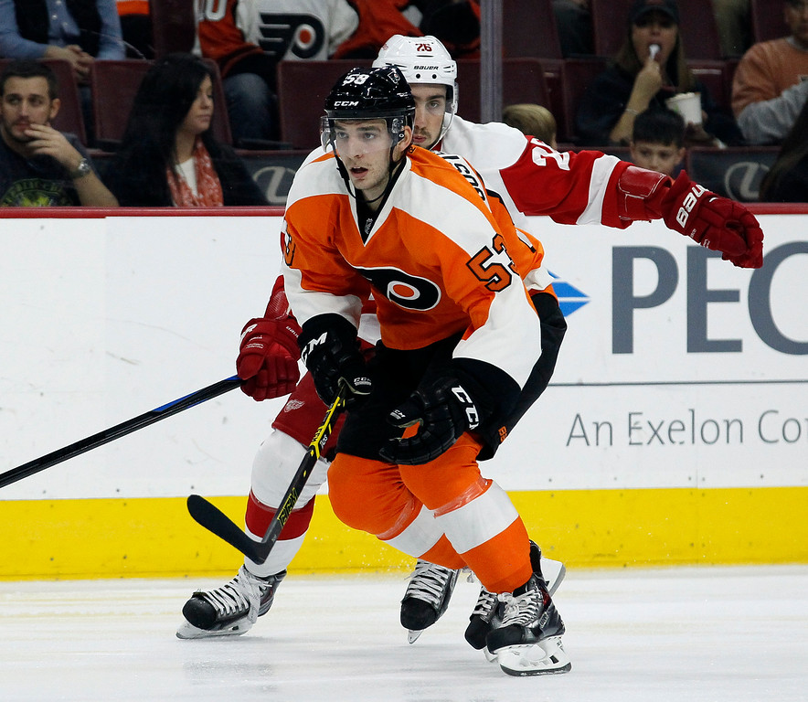 . Philadelphia Flyers\' Shayne Gostisbehere (53) skates away from Detroit Red Wings\' Tomas Jurco (26) in the first period of an NHL hockey game, Saturday, Oct. 25, 2014, in Philadelphia. The Flyers won 4-2. (AP Photo/Tom Mihalek)