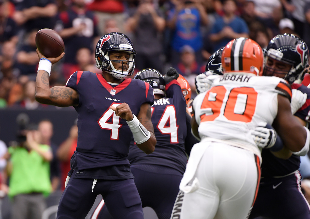 . Houston Texans quarterback Deshaun Watson (4) throws a pass under pressure from Cleveland Browns defensive end Emmanuel Ogbah (90) in the first half of an NFL football game, Sunday, Oct. 15, 2017, in Houston. (AP Photo/Eric Christian Smith)