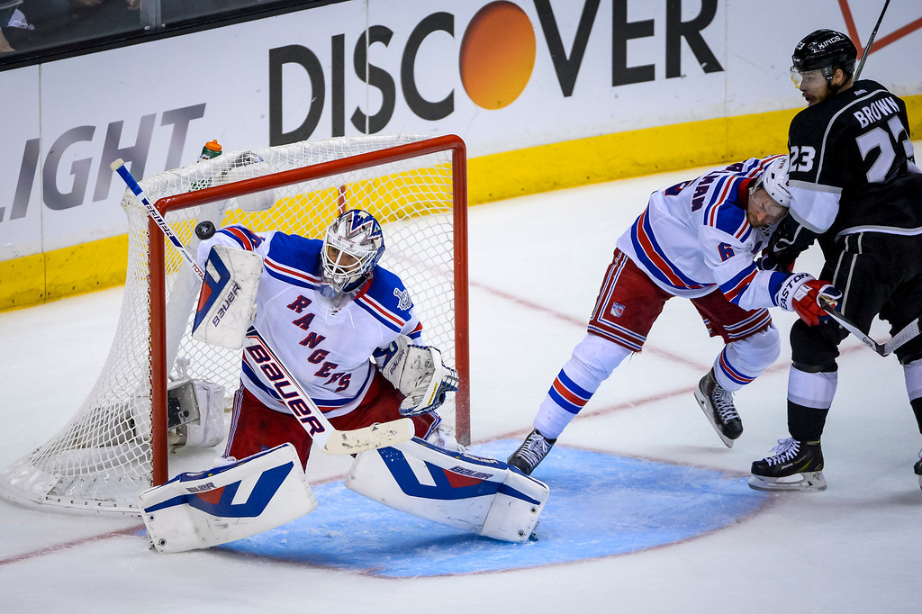 . Rangers Henrik Lundqvist blocks this shot by Kings Dustin Brown during third period action at Game 1 of the Stanley cup Finals at Staples Center Wednesday, June 4, 2014 ( Photo by David Crane/Los Angeles Daily News )