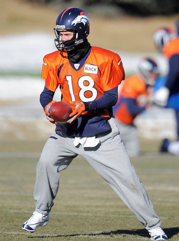 . Denver Broncos quarterback Peyton Manning (18) looks to hand off during practice Wednesday, January 2, 2013 at Dove Valley.  John Leyba, The Denver Post