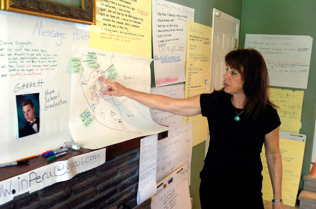 . Photos, maps, contacts and other information cover a wall as Francine Fitzgerald, mother of missing bicyclist Garrett Hand, talks about efforts to find her son at her home in Concord, Calif. on Monday, Feb. 25, 2013. Hand and girlfriend Jamie Neal have not been heard from in a month after going missing during a bicycling trip in Peru. (Kristopher Skinner/Staff)