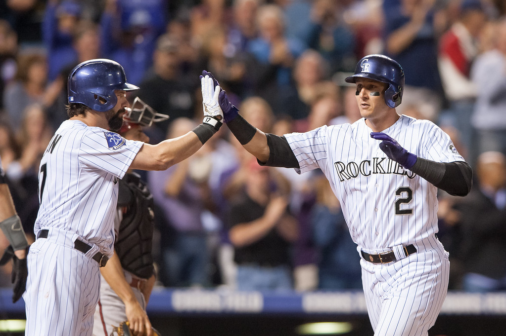 . DENVER, CO - SEPTEMBER 20:  Troy Tulowitzki #2 of the Colorado Rockies celebrates a seventh-inning home run against the Arizona Diamondbacks with teammate Todd Helton #17 at Coors Field on September 20, 2013 in Denver, Colorado. (Photo by Dustin Bradford/Getty Images)