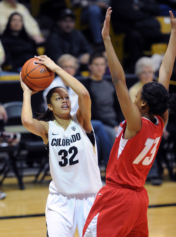 . Arielle Roberson of CU shoots over Khadijah Shumpert of UNM during the first half of the December 29, 2012 game in Boulder. Cliff Grassmick / December 29, 2012