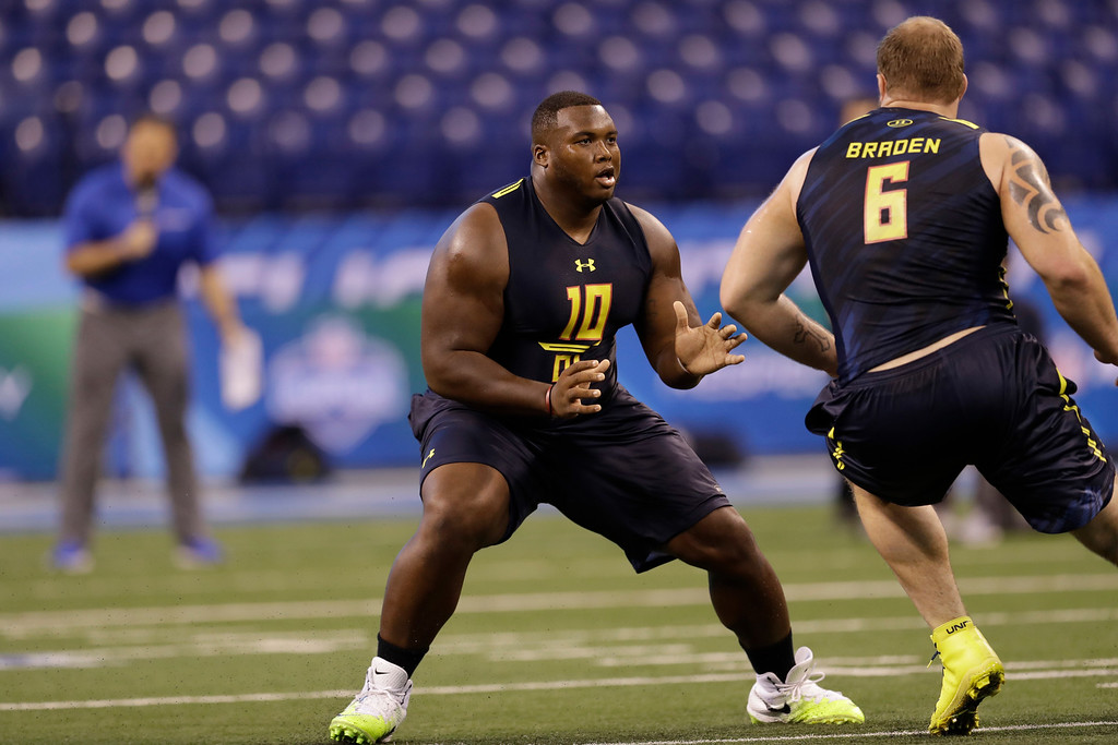 . Indiana (Pennsylvania) offensive lineman Ethan Cooper runs a drill at the NFL football scouting combine Friday, March 3, 2017, in Indianapolis. (AP Photo/David J. Phillip)