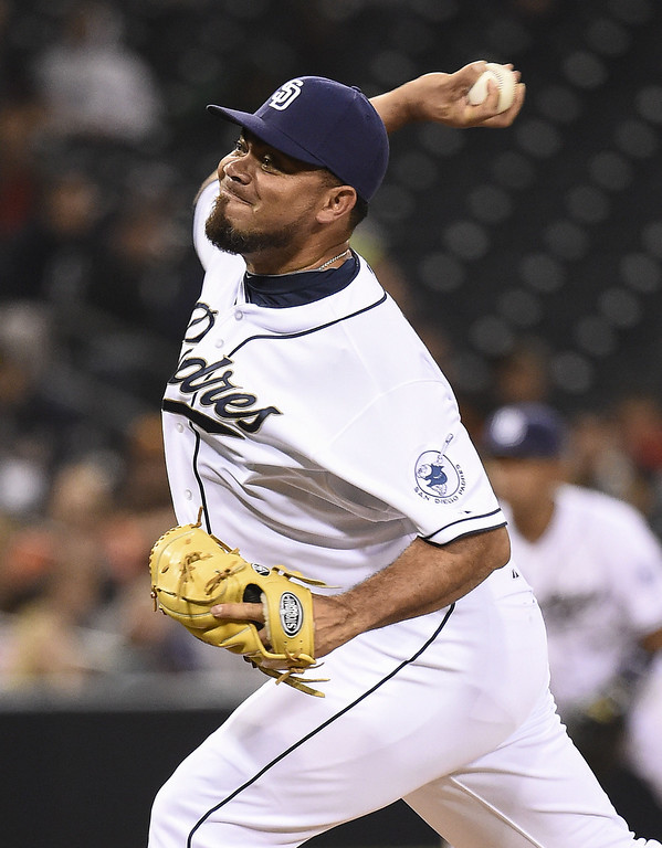 . SAN DIEGO, CA - APRIL 16:  Joaquin Benoit #56 of the San Diego Padres pitches during the eighth inning of a  baseball game against the Colorado Rockies at Petco Park April 16, 2014 in San Diego, California.  (Photo by Denis Poroy/Getty Images)