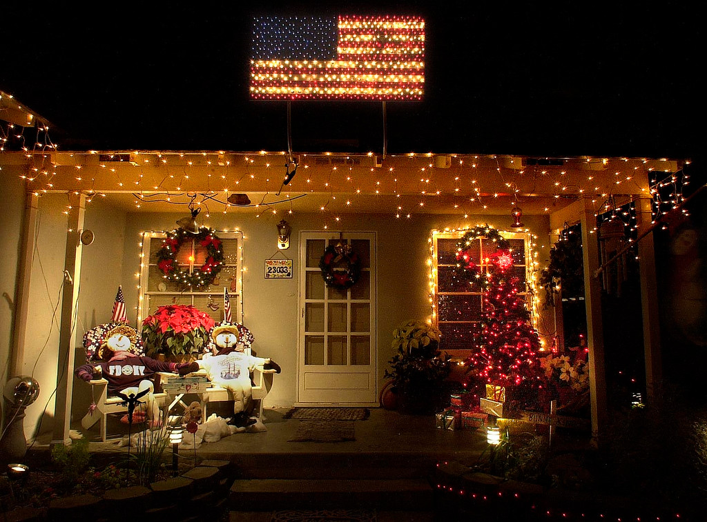 . Candy Nolan decorated her Sleepy Hollow home with an electric flag and two stuffed figures wearing patriotic shirts. Photo/bruce Hazelton 12/5/01