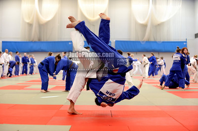 2013 Tonbridge Judo Training Camp 131220A5418: Junior World Champion, Kazlek Zankishiev of Russia (white), throws Reece Calder of Great Britain fo....